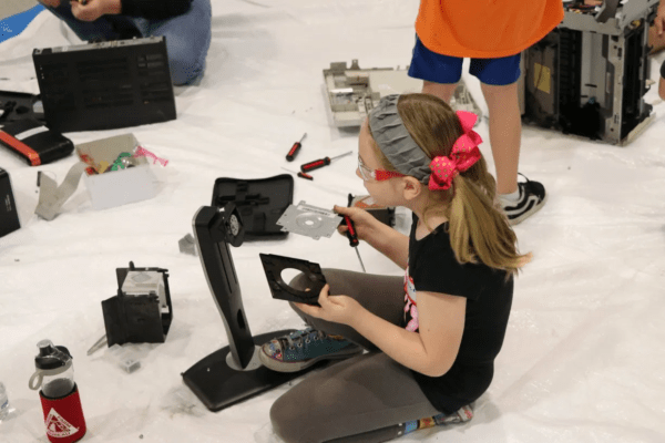 Picture of a young girl assembling a device
