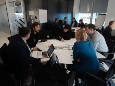 Picture of a team in a business meeting in an office