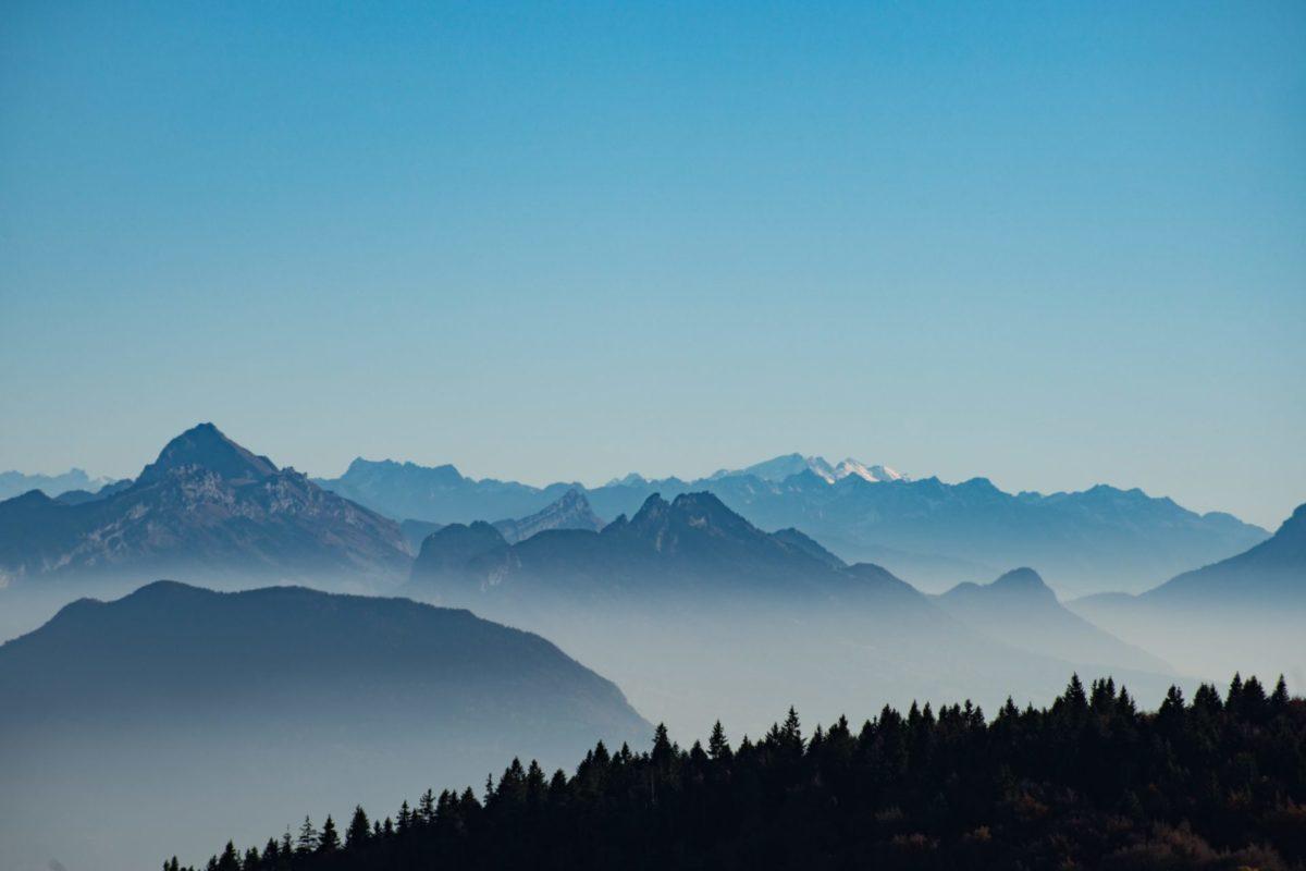 Foggy mountain range near the forest