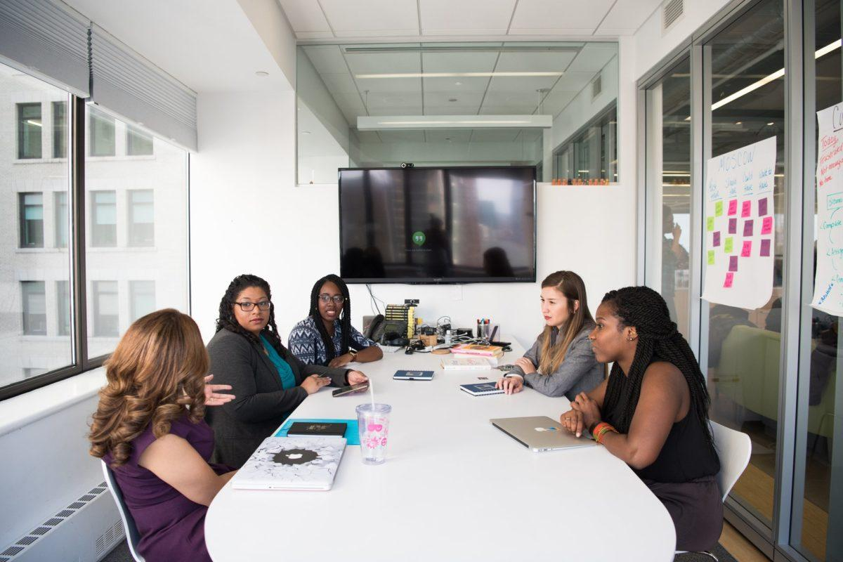 A team in a business meeting in a conference room